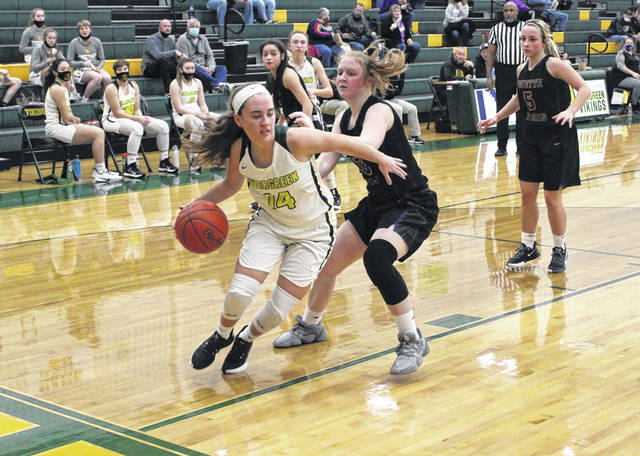 Evergreen's Bekah Bowser drives along the baseline during Tuesday's game with Fayette. The Vikings defeated the Eagles handily, 66-25.