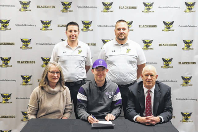 Tommy McWatters of Pettisville has signed with Taylor University in Upland, Indiana to continue his academic and golf career. Front row, from left: Angie McWatters (mother), Tommy McWatters, Thomas McWatters (father). Back row: Mike Zimmerman (Pettisville golf coach) and Tom Lammers (Pettisville assistant coach).