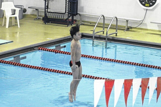 Austyn Schweinhagen completes a dive for Wauseon during their meet against Bowling Green Tuesday. He took first in the boys competition with a score of 130.3.