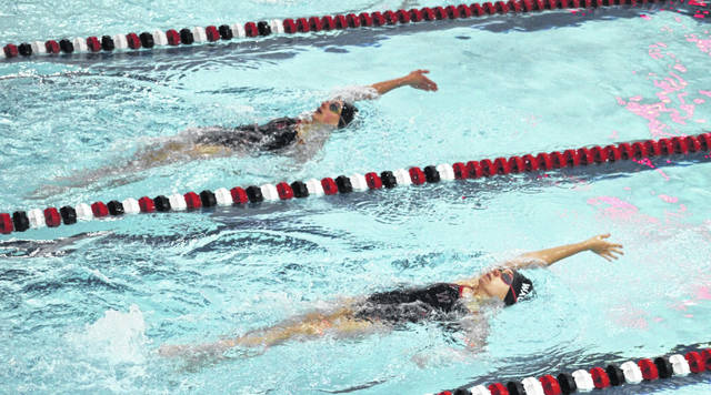 Wauseon's Natalie Kuntz, top, and teammate Ashley Freestone compete in the 200 IM at a home meet with Bryan Thursday. Kuntz won the race and posted a time of 2:30.93.