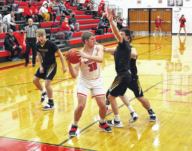 Isaac Wilson of Wauseon looks to pass out of the low block Tuesday in a non-league contest against Fairview. The Indians led by double digits for most of the game, resulting in a 55-43 victory.