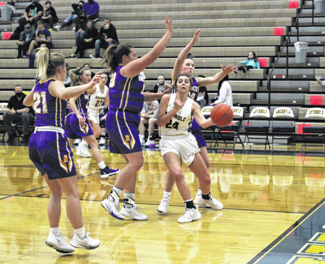 Addi Ziegler drives the baseline and then makes a pass during Archbold's game against Holgate on Tuesday. The Blue Streaks would earn a 56-33 win over the Tigers.