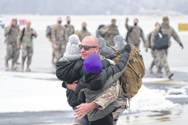 Members of the Ohio National Guard's 180th Fighter Wing were greeted with hugs and tears on Tuesday afternoon after returning from Afghanistan. The airmen returned following overseas deployments throughout the Central Command Area of Responsibility. Throughout 2020, more than 400 Stinger Airmen deployed to seven countries within the CENTCOM region to support several individual, six-month, Agile Combat Support deployments as well as a three-month Aerospace Expeditionary Force deployment. The individual ACS deployments began departing the 180th Fighter Wing between April and July. While those ACS members who deployed in early spring began returning home in October, the summer ACS deployers began returning home this month, with the final Airmen returning home Tuesday. The AEF deployment included a 12 aircraft and 300 Airman aviation package to Bagram Air Base, Afghanistan. The deployments were in support of Operation Resolute Support.