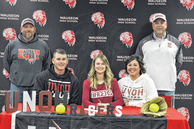 Payton Albright of Wauseon recently committed to continue her education and softball career at the University of Northwestern Ohio in Lima. Pictured are, front row, from left, Alan Albright (father), Payton, Beth Albright (mother). Back row: Wauseon softball coach Mark Schang, Wauseon assistant coach Roy Norman.