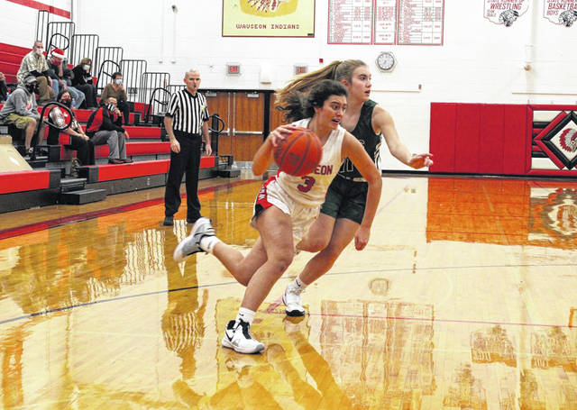 Wauseon's Addy Case dribbles around a Tinora defender during a game earlier in the season. Recently, Wauseon received the fifth seed in the Division III, Whitehouse District and will play host to rival Archbold in a sectional semifinal on Thursday, Feb. 18.
