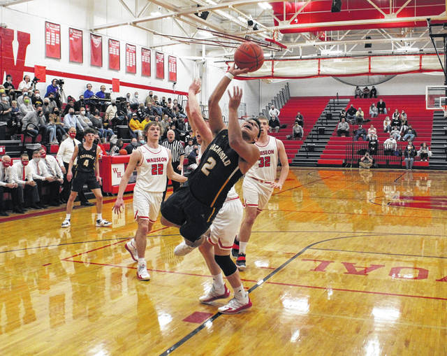 Noah Gomez of Archbold shoots an off-balance shot after drawing a Wauseon foul during Friday's NWOAL finale. The Blue Streaks would pull away from the Indians in the second half to capture the outright league title.