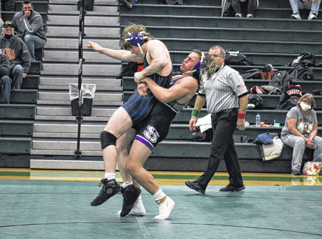 Hunter Gowing of Swanton body slams a wrestler from Anthony Wayne during a quad meet at Delta Thursday. In the Lima Central Catholic Invitational held Friday and Saturday, Gowing would finish seventh at 160 pounds.