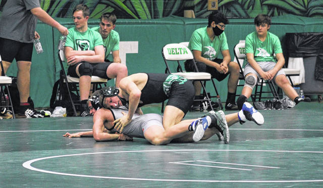 Delta's Zack Mattin, top, wrestles in a dual against Liberty Center in a quad at Delta on Jan. 28. The Panthers competed in the OHSWCA Division III Dual Meet State Championships on Saturday where they took third as a team.