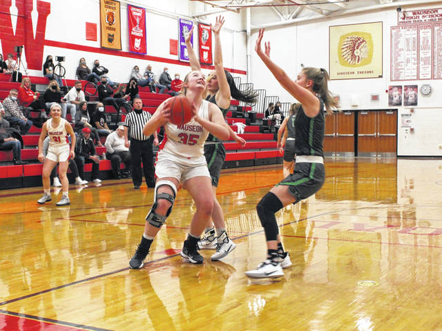 Hayley Meyer of Wauseon maneuvers her way inside versus Delta Thursday in NWOAL girls basketball. The Indians knocked off the Panthers as both teams finish 5-2 in league play.