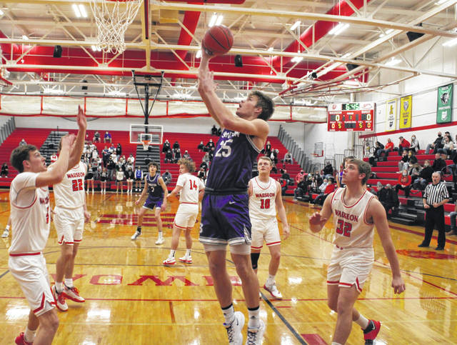 Swanton's Cole Mitchey lays one in during a NWOAL game at Wauseon this season. Tournament draws were revealed on Sunday for local boys basketball teams.