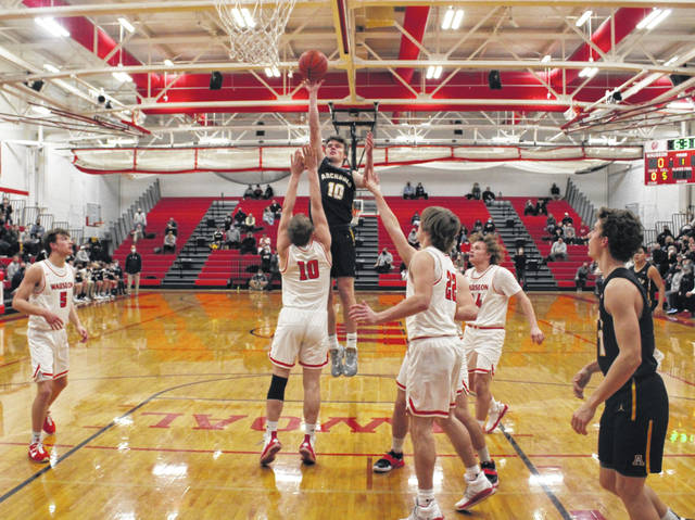 Archbold's DJ Newman hits a floater in a game at Wauseon Friday to decide the NWOAL boys basketball crown. He led all scorers with 21 points as the Blue Streaks took down the Indians, 52-37.