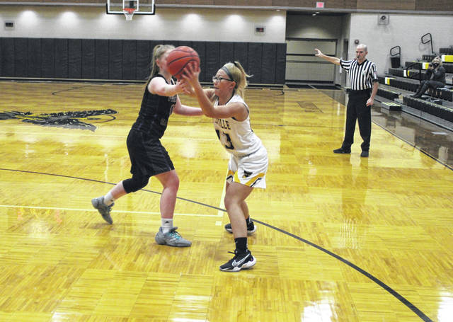 Meleah Plank of Pettisville feeds a pass inside during Tuesday's BBC matchup with rival Fayette. The Blackbirds recorded their second straight win by beating the Eagles 37-19.