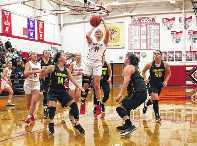 Wauseon's Chelsie Raabe knocks down a two-point basket Thursday in a NWOAL matchup with Evergreen. The Indians topped the Vikings by a 65-45 final.
