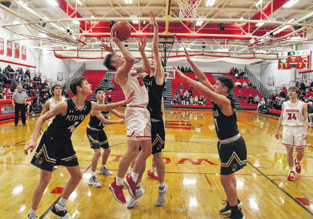 Noah Sauber of Wauseon converts a basket down low versus Pettisville Saturday night. The Indians won both games over the weekend, besting Delta Friday and Pettisville on Saturday.