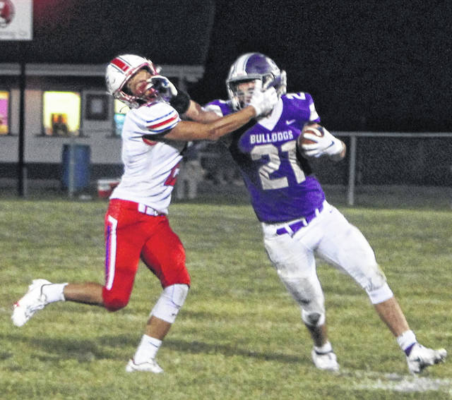Swanton's Ian Saunders carries the ball in a Northwest Ohio Athletic League contest against Patrick Henry last season. There have been discussions regarding Swanton leaving the league.