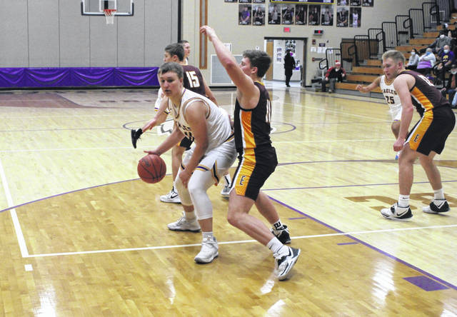Fayette's Tanner Wagner backs down Gannon Ripke of Edgerton in the second half of Tuesday's non-league boys basketball game. Wagner, one of five Eagles honored on Senior Night, was key in his team's 49-47 win over the Bulldogs.