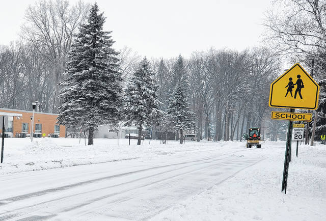 The parking area for Swanton Elementary School on Crestwood Drive is cleared Sunday morning. At Toledo Express Airport 4.6 inches of snow was reported from the weekend storm.