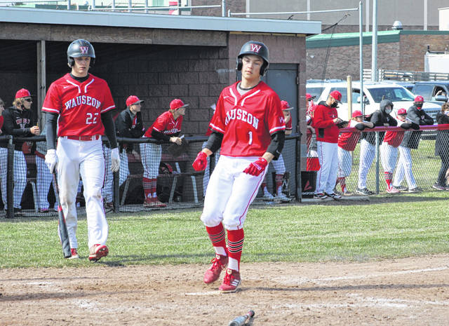Clay Stump trots home for a Wauseon run in the bottom of the eighth inning during Saturday's baseball season opener with Defiance. After the game went to extra innings, Defiance scored six in the top half of the eighth to help them to a 7-3 victory.