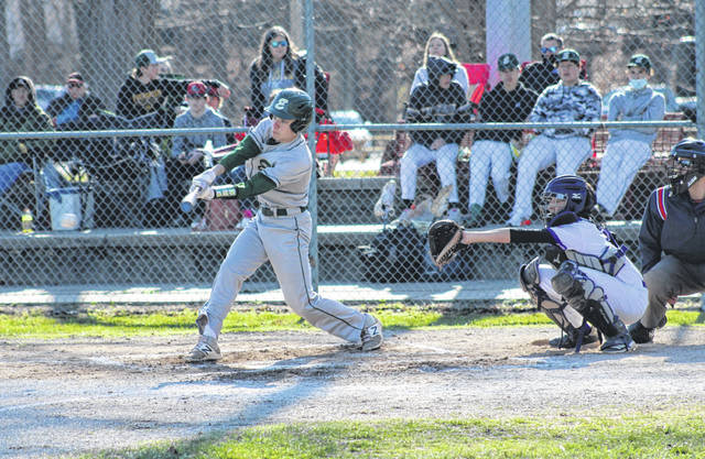 Evergreen's Payton Boucher puts a ball in play during a game at Swanton Monday. The Vikings defeated the Bulldogs 13-1 then visited Delta Tuesday where they came away with an 11-5 victory.