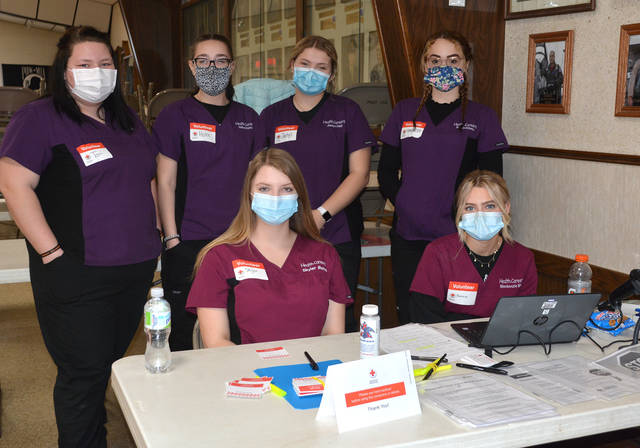 Four County Career Center's HOSA Future Health Professionals Chapter recently sponsored the Red Cross Blood Drive at the Ridgeville Corners Legion Hall. HOSA Officers assisted in registrations, temperature checks, and as donor guides throughout the blood drive. Shown at the Red Cross Blood Drive are HOSA Officers and Health Careers students, from left, in front row, Skyler Marks (Patrick Henry); Kenzie Biliti (Defiance); and back, Tori Johns (Archbold); Hailee Kanthak (Evergreen); Jaelyn Hall (Bryan); and Makenzie DeSantos (Delta). Four County HOSA Advisor Robin Hill, Health Careers instructor, coordinated the event.