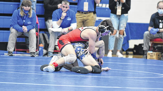 Connor Twigg of Wauseon, top, holds down an opponent in a match at 152 pounds during the Division II State Individual Wrestling Tournament held earlier this month.