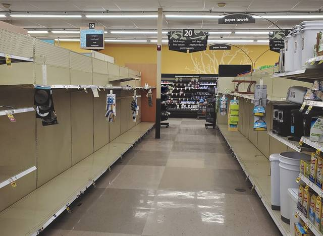 As restrictions imposed due to COVID-19 increased last March, customers flocked to stores to stock up, leaving shelves for items such as toilet paper and paper towels empty at Kroger in Swanton.
