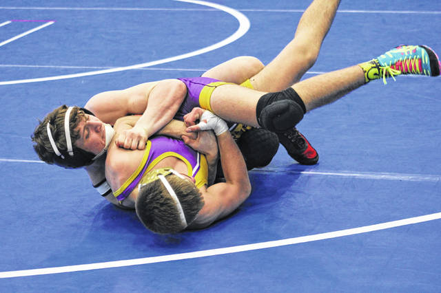 Wauseon's Lawson Grime, left, in a match at the sectional tournament at Defiance in late February. Grime placed third at 132 pounds to advance out of the Norwalk District this past weekend, advancing to state.