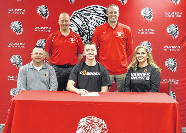 Layton Willson of Wauseon recently committed to continue his education and running career at Lourdes University. Front row, from left: Wes Willson (father), Layton, Nikki Willson (mother). Back row: Wauseon assistant cross country and track coach Tom Vernot, Wauseon head cross country and boys track coach Joe Allen.