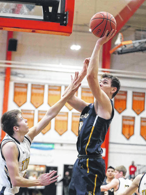 Archbold's Ashton Kammeyer shoots over Ottawa-Glandorf's Eli Schmenk during the Division lll regional semifinal at Elida High School on Wednesday. Kammeyer paced the Blue Streaks with 18 points on the night.