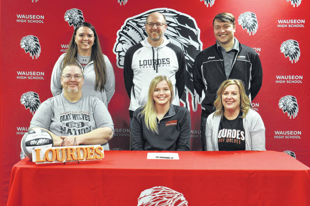 Wauseon's Chelsie Raabe recently committed to continue her education and volleyball career at Lourdes University in Sylvania. Front row, from left: Tim Raabe (father), Chelsie, Julie Raabe (mother). Back row: Wauseon volleyball coach Kelsey Wulf, Lourdes volleyball coach Greg Reitz, Lourdes assistant coach Ryan Ferkel.