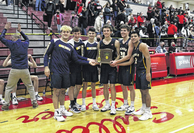 Archbold basketball seniors hold the Division III district championship trophy following Saturday's 59-56 win over top-seed Cardinal Stritch in a game at Toledo Central Catholic High School. The Blue Streaks now advance to the regional at Elida where they will take on Ottawa-Glandorf Wednesday night.