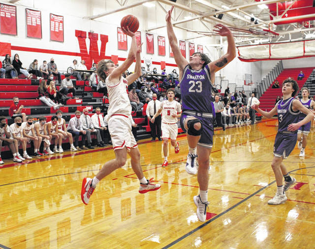 Swanton's Andrew Thornton (23) blocks Connar Penrod of Wauseon's shot during a NWOAL meeting between the two teams this season. Thornton received All-District 7 first team honors in Division III while Penrod was recognized with first team honors in Division II.