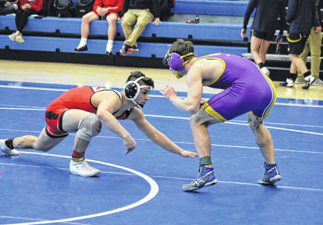 Connor Twigg of Wauseon, left, looks to take out the legs of his opponent, Michael Wolff of Bryan, in his first match at 152 pounds Friday in the sectional tournament. He won that match 21-6 and went on to capture a sectional title.