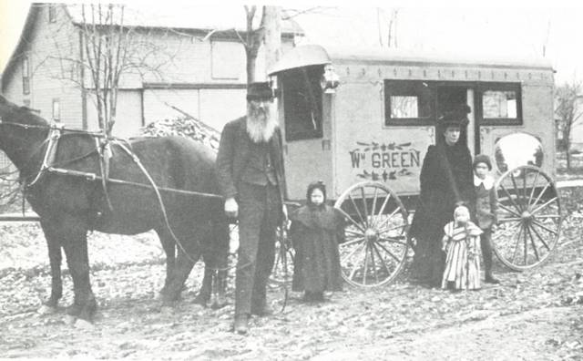 William Green, his wife and three children pictured with the first camper in Fulton County. It was built circa 1900. Green designed this camper so that he and his family could attend the Michigan State Fair in Detroit. He would design and build a larger camper, still horse drawn, in 1906. William Green, a prominent citizen of Lyons, was at one time President of the Commercial Savings Bank and built the bank building as well as several other buildings in Lyons. Green planted many trees on land that he owned in the south part of the village and donated this land to the village to be used as a park. Green Memorial Park still exists and his named after him.