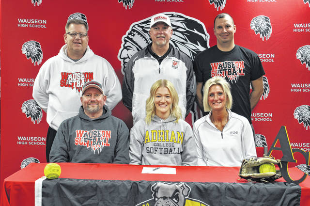 Wauseon's Macee Schang recently committed to continue her education and softball career at Adrian College in Michigan. Front row, from left: Mark Schang (father, Wauseon softball coach), Macee, Leslie Schang (mother). Back row: Wauseon assistant softball coaches Ron Burget, Roy Norman, Nick Lavinder.