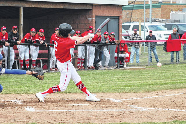 Kolton DeGroff of Wauseon fouls a ball down the left field line during Saturday's baseball season opener versus Defiance. The Indians would fall to the Bulldogs in extra innings, 7-3.
