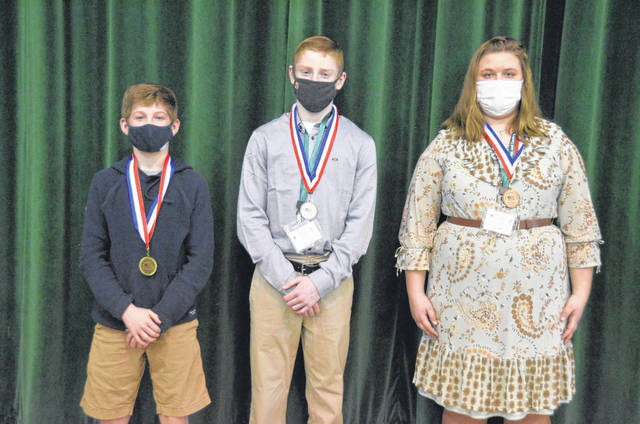 The top three in the 14-15 age group were, from left, Adam Mattin, Landon Lindermoot, and Estella Hilyard.