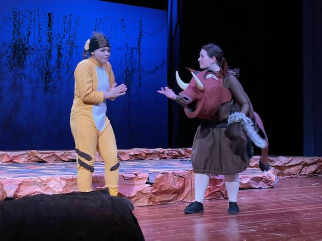 Timon (Karmon Goolsby) and Pumbaa (Olivia Gigax) worry about the carnivorous sounds they hear in the jungle.