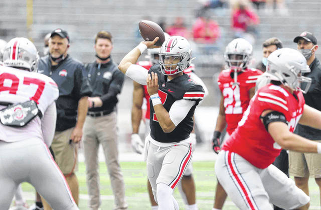 C.J. Stroud looks for someone to throw to over the middle during Saturday's Ohio State Spring game in Columbus.