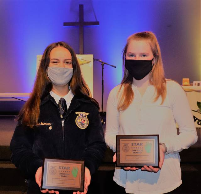 Star Greenhands Sophie Sterken, left, and Mina Wesche with their plaques.