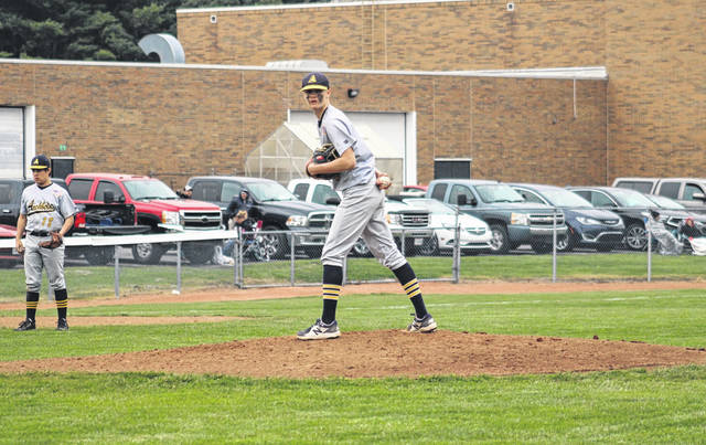 Archbold pitcher Jayden Seiler checks a runner at first base during a NWOAL game at Delta on Monday afternoon. He struck out eight Panthers while on his way to helping the Blue Streaks to a 10-0 six-inning victory.