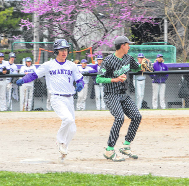 Swanton's Kyler Stevens is thrown out at first base as Chase Stickley of Delta covers during Thursday's NWOAL matchup.