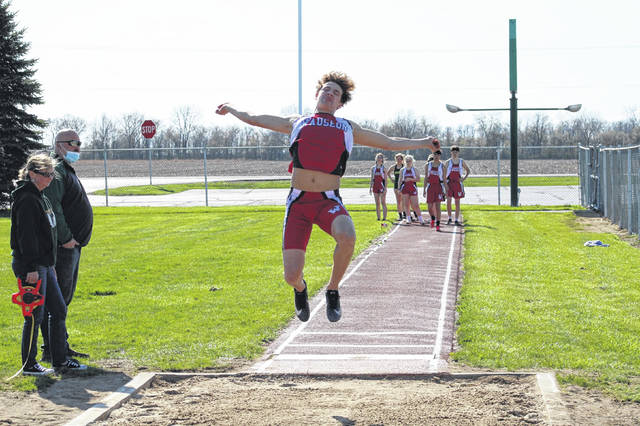 Jonas Tester of Wauseon goes airborne in the long jump at a dual meet with Evergreen Tuesday. He won the event with a jump of 20 feet, 6 and 1/2 inches.