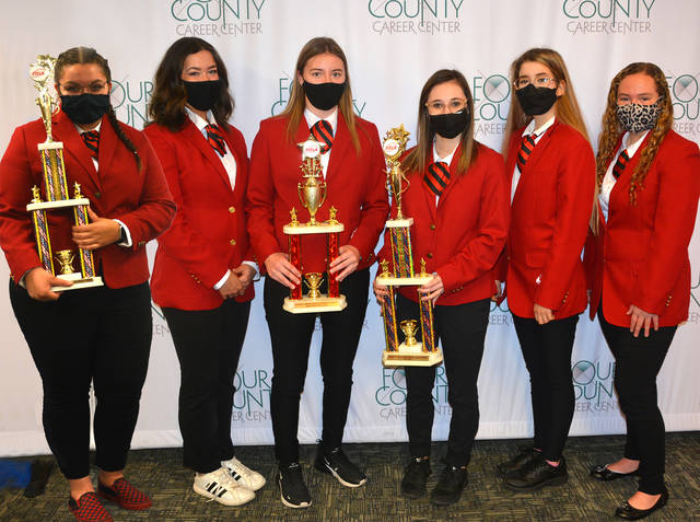 Six students from Four County Career Center's Family, Career and Community Leaders of America (FCCLA) have earned gold or silver medals at the State FCCLA Leadership Conference. Three of these students have earned the right to advance to national competition to be held virtually in June. Shown are state winners - from left - Raylynn Miler of Tinora, silver medalist, competing at Nationals; Lena Bassett of Hicksville, silver medalist; Lorelle Hetrick of Fairview, silver medalist competing at Nationals; Daisy Jack of Bryan, silver medalist competing at Nationals; Taylor Harter of Tinora, silver medalist; and Miranda Bachman of Napoleon, silver medalist. The FCCLA participants are challenged to complete a project in their area of career and technical training within a specified time period while being scored by a panel of judges. Family, Career and Community Leaders of America is a national organization for high school and college students. The career center's FCCLA lead advisors are Michele Nafziger and Kelli Alspaugh.