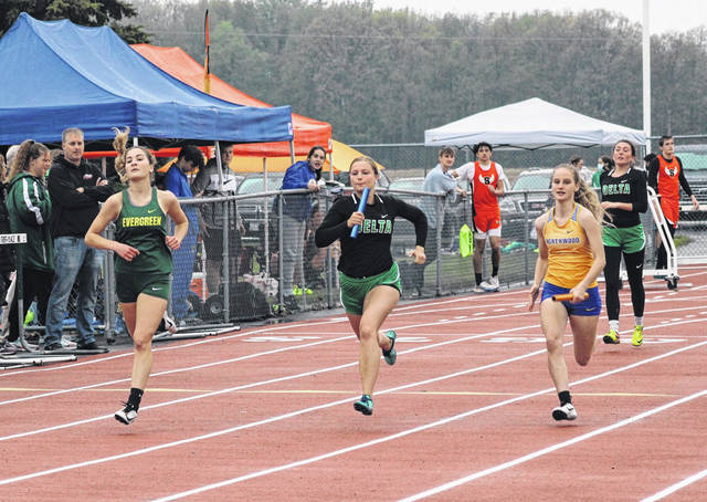 Brooklyn Wymer, center, finishes up the 4x100 meter relay for Delta Monday at the TJ Rupp Invitational at Evergreen. The Panthers took second in the event while Evergreen's team consisting of Brianna Sintobin, Deanna Hoffman, Anna Huntzinger, left, and Andrea Vanwert was first.