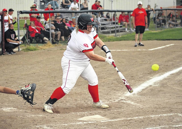 Jettie Burget of Wauseon hits an RBI single during a Division II softball district semifinal against Clyde Wednesday, May 19 at Genoa. The Indians defeated Clyde 10-0 and then Oak Harbor 13-9 in the district championship on Saturday.