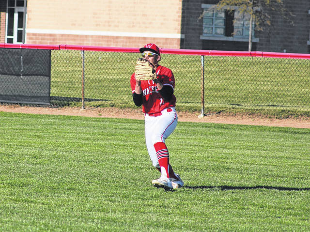 Cameron Cantu of Wauseon squeezes an out in right field during a game with Springfield Thursday. The Indians shut out the Blue Devils 10-0 in six innings.