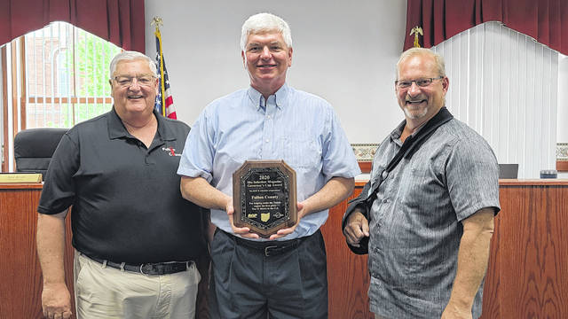 Fulton County Commissioners Jon Rupp, Jeff Rupp, and Joe Short, with the award.