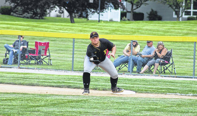 Pettisville first baseman Nate Keim records an out on a North Central sacrifice bunt in the top of the second inning of Thursday's D-IV sectional final. The Blackbirds were defeated by the Eagles, 7-3.