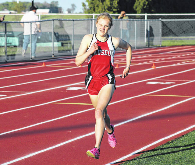 Wauseon's Grace Rhoades runs in the 1600m Friday during the finals of the NWOAL Track and Field Championships. She was runner-up to Liberty Center's Hope Oelkrug.